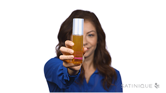 Background image showing woman holding Satinique™ Dual Defend Spray.