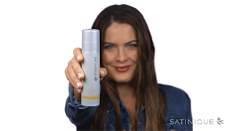 Background image showing woman holding Satinique™ Straightening Balm.