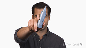 Background image showing man holding Satinique™ Scalp Tonic.