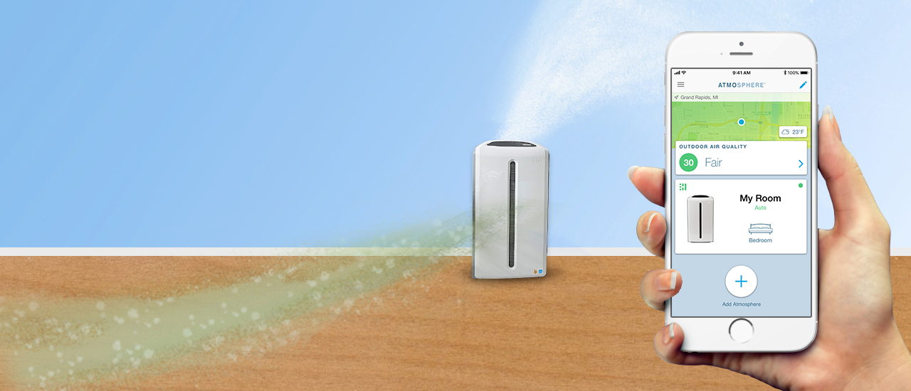 Graphic representation of air flowing into the Atmosphere™ Sky air treatment system and out the top as filtered air. The foreground shows a hand holding a smartphone with the Atmosphere™ Connect App.