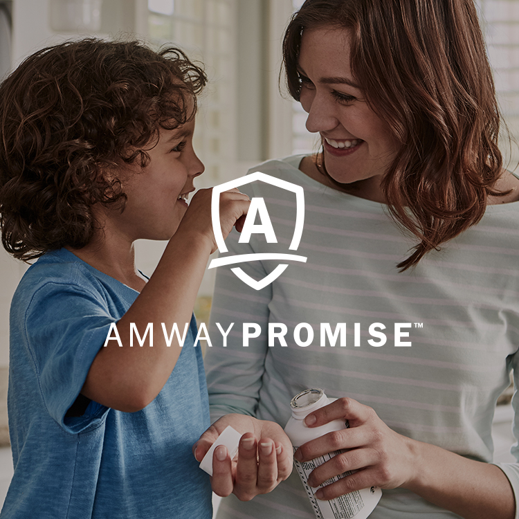 Mother and child in kitchen with Amway Promise logo over the image.