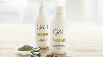 G&H Refresh+™: Revitalize your skin. Background image shows G&H Refresh+™  Body Milk, G&H Refresh+™  Body Wash – Gel, surrounded by fresh aloe vera leaves, green tea powder, grape seeds.