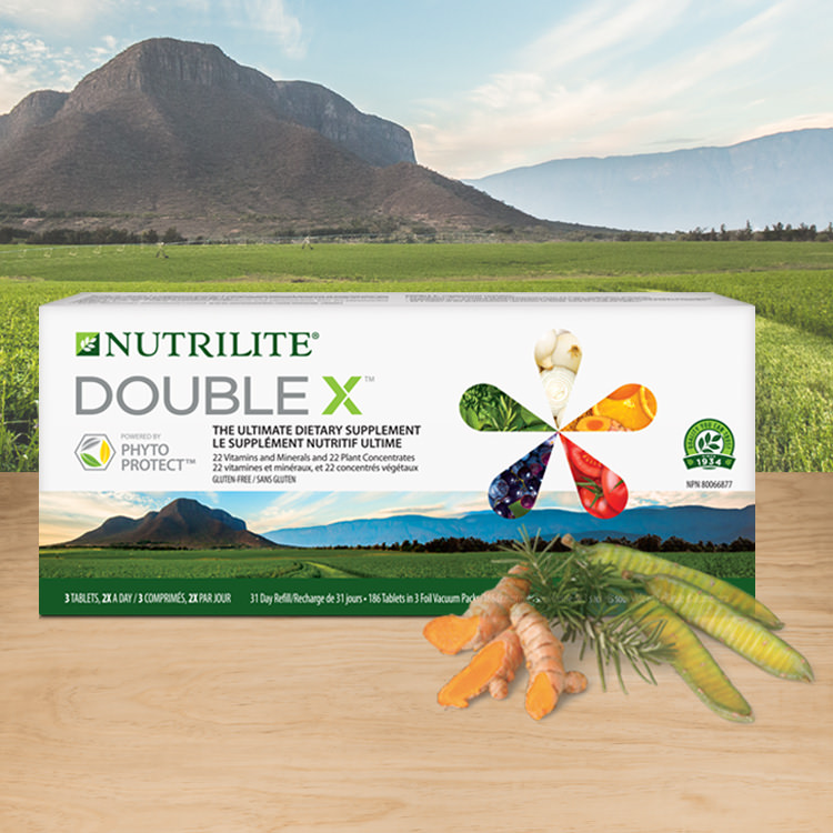 Nutrilite™ Double X™ Multivitamin. Background image shows Amway certified organic farm in Trout Lake, Washington.