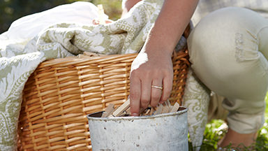 See how Amway Home™ does the work for you. Background image showing a woman lifting a wicker basket full of clean laundry.