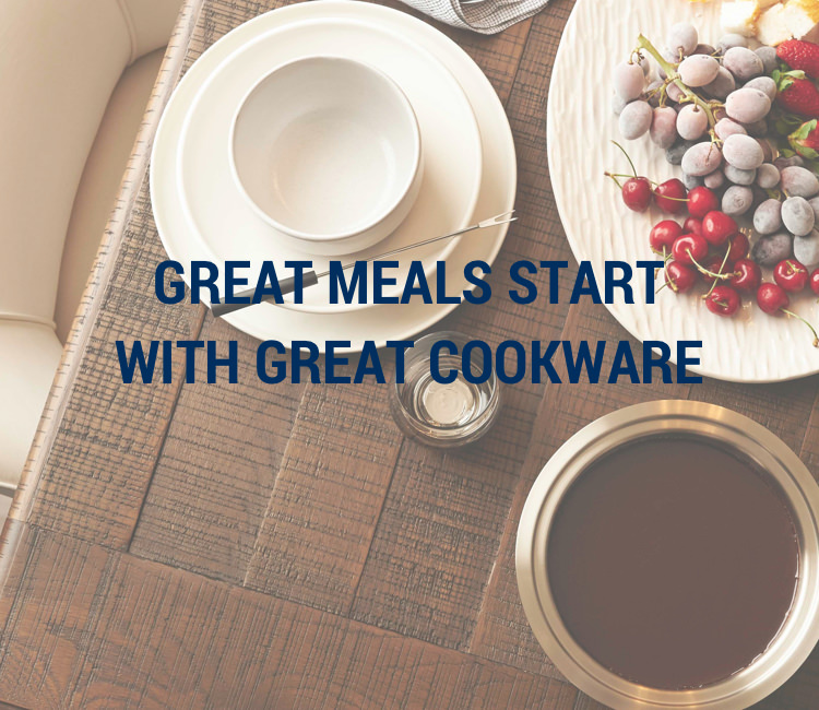 Great meals start with great cookware. Background image shows a table with dinner place settings. Fruit and cheese are on a center platter.