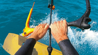 Sports nutrition fuels your active life. Learn how. Background images shows hands of someone kiteboarding in the ocean.