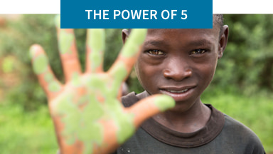 The Power of 5: Help us end global childhood malnutrition. Background image shows a child holding up five fingers.